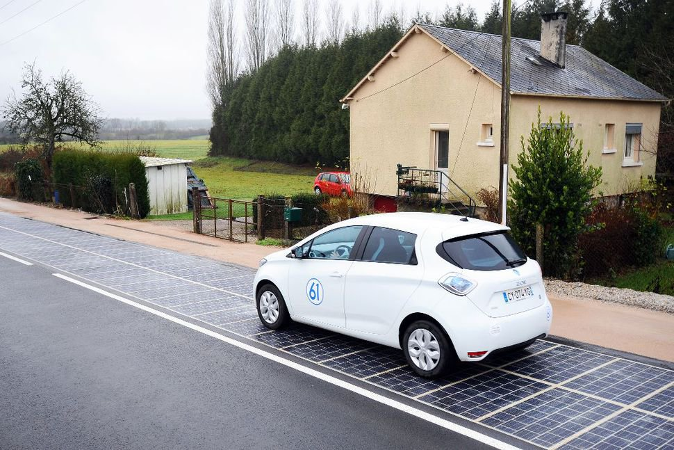 car on solar road in france