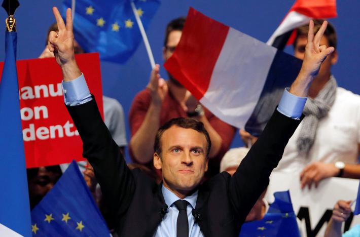 Emmanuel Macron, head of the political movement En Marche! and candidate for the 2017 presidential election, waves to supporters at the end of a campaign rally in Pau