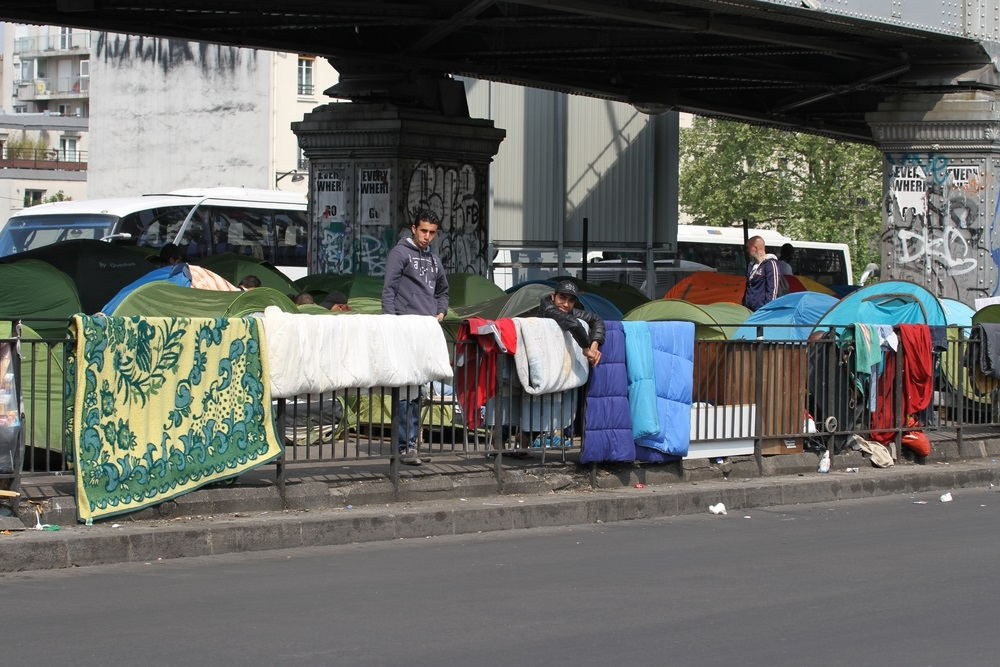 refugees living under a bridge in Paris France
