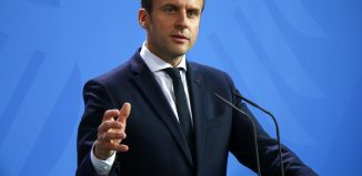 Macron pushes labour rule