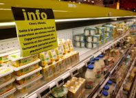 A placard explaining the butter shortage is displayed on milk products shelves at a supermarket in Saint-Sebastien-sur-Loire