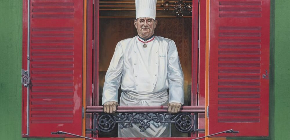 Facade of the restaurant Paul Bocuse with his portrait. Paul Bocuse, 3 stars at the Michelin guide, is a famous french chef in the world and based in Lyon, France
