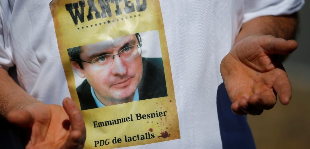 A French dairy farmer from the FNSEA union wears a tee-shirt bearing a picture of Emmanuel Besnier, CEO of Lactalis