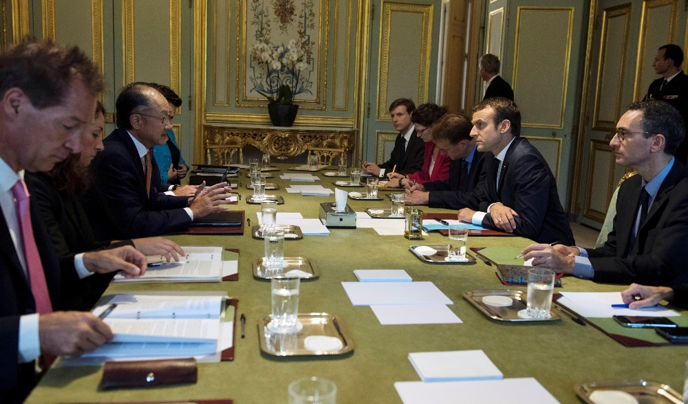 French President Emmanuel Macron and World Bank Group President Jim Yong Kim attend a meeting at the Elysee Palace in Paris