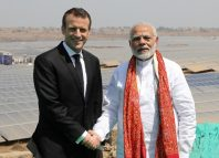 Indian Prime Minister Narendra Modi and French President Emmanuel Macron pose during the inauguration of a solar power plant in Mirzapur (1)