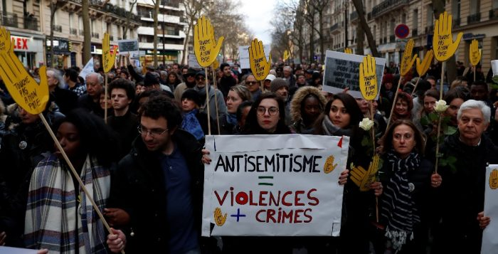 People attend a gathering organised by the CRIF Jewish organisation in memory of Mireille Knoll in Paris