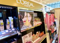 cosmetic products sit on display for sale at Olive Young shop at Lotte Department Store in Busan.