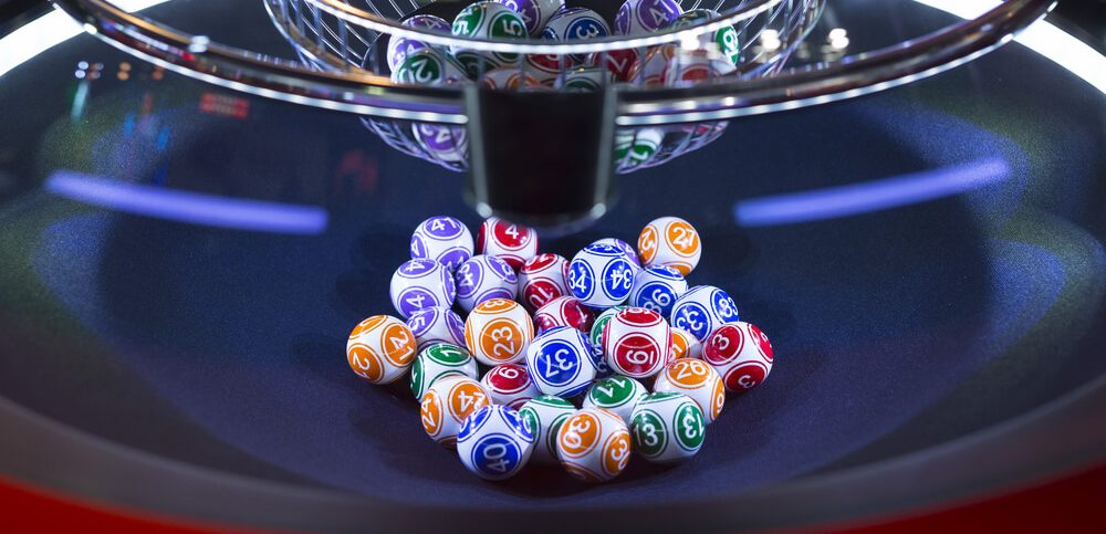 Colourful lottery balls in a rotating bingo machine