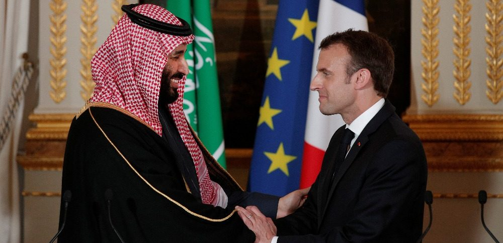 French President Emmanuel Macron and Saudi Arabias Crown Prince Mohammed bin Salman shake hands following their press conference at the Elysee Palace in Paris