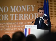 French President Emmanuel Macron gives a speech as part of an international conference