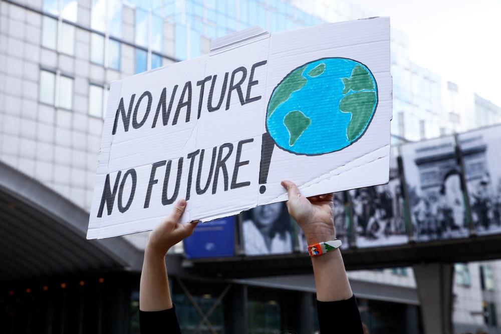 Activists during a demonstration to demand an action on climate change in front of European Parliament
